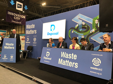 Photograph of Waste Matters theatre with Ray Georgeson - Resource Association (chair), Sophie Walker - Dsposal, Jon Hastings - London Borough of Newham, Rachel Scarisbrick - Keep Britain Tidy, Alistair Paul - Defra, Dan Cooke - Pennon Group/ESA.